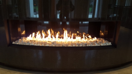 Incredible curved gas fireplace close up