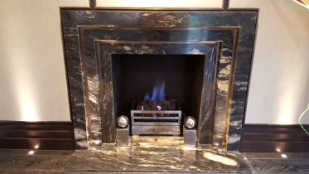Completed black marble fireplace installation in Wentworth