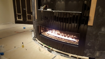 curved gas fireplace in a games room