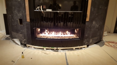 installation of a curved gas fireplace in a games room
