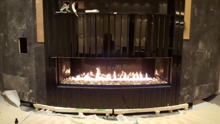 curved gas fireplace close up in a games room