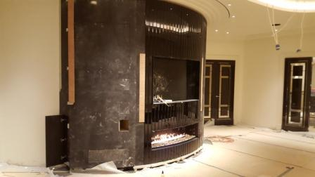 installation of curved gas fireplace