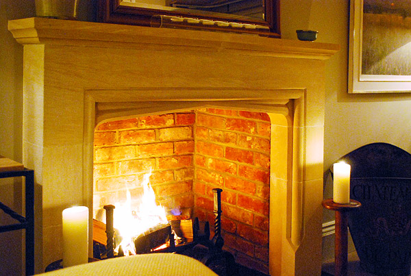 Limestone Tudor traditional fireplace in Surrey