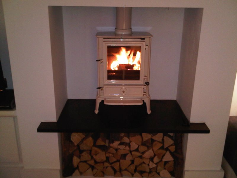 Ivory wood burning stove with log storage beneath