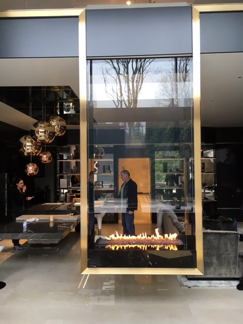 Hanging bespoke fireplace with double sided glass and gas burner