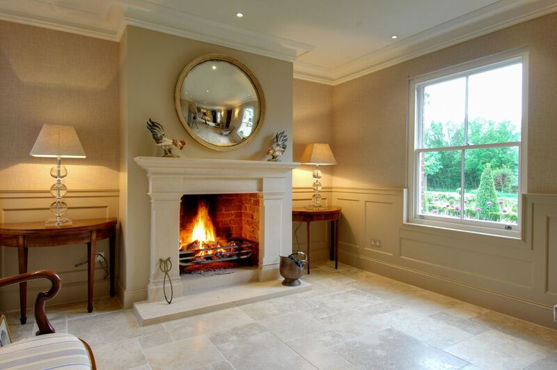 Beautiful bathstone hallway traditional fireplace installation in Winchester