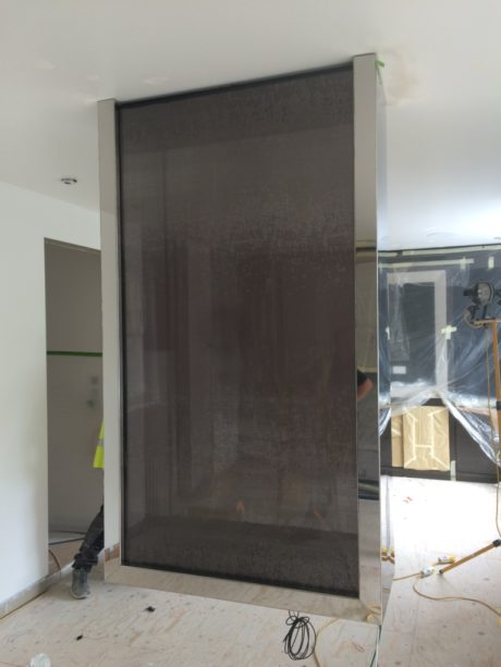 Hanging fireplace in the bedroom with fabric on glass